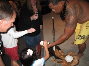At our official Luau - we were stuck indoors because of the rain. This guy taught us how to open a coconut. We kept the (actually tasty) mai tais coming during the whole three-hour event.